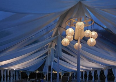 uplit draping and Amish wagon wheel chandelier